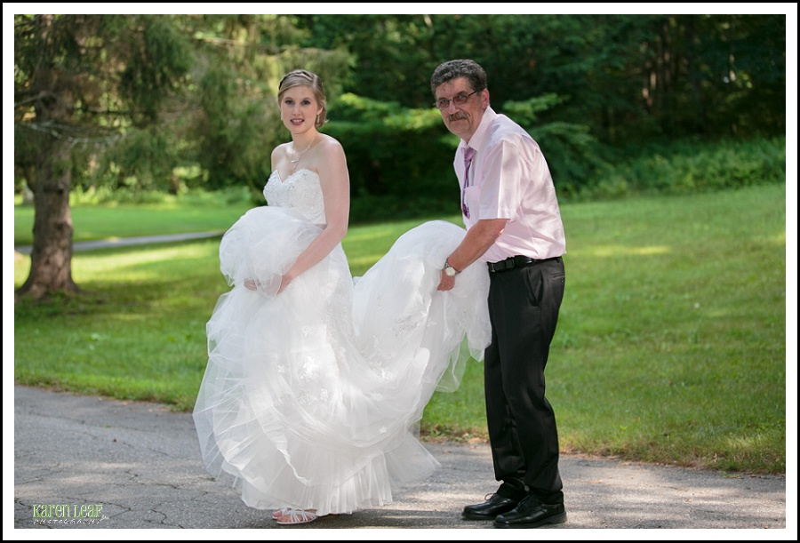dad helping bride with dress