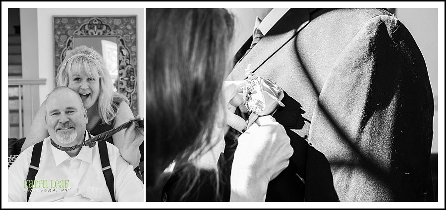 black and white groom pinning flowers