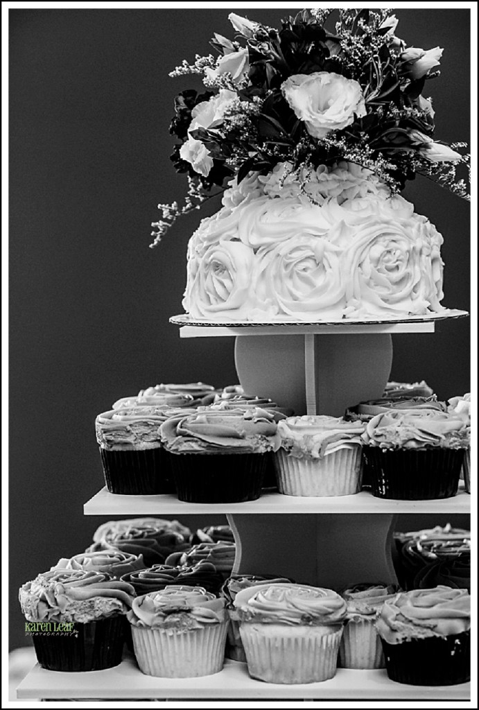 black and white wedding cake and cupcakes