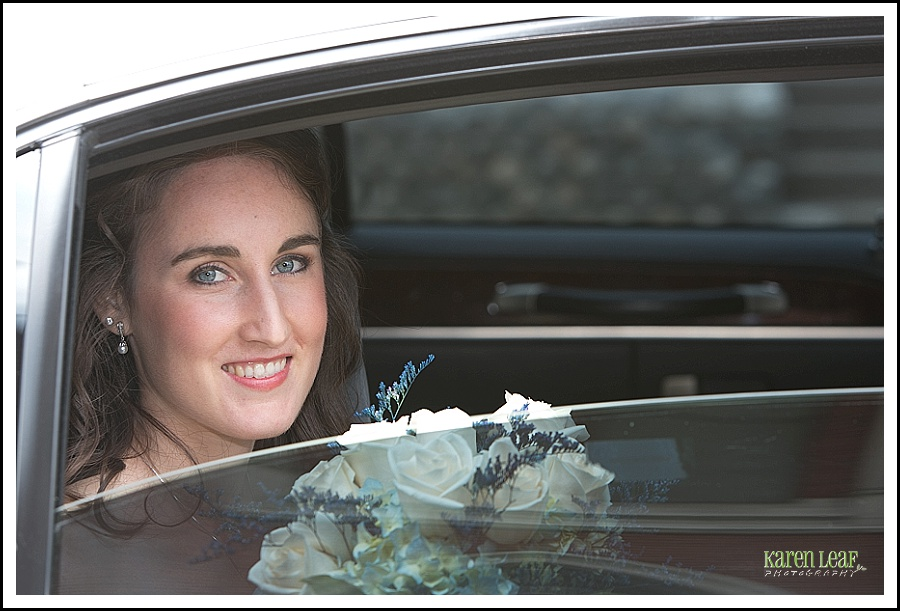 beautiful bride looking out car window