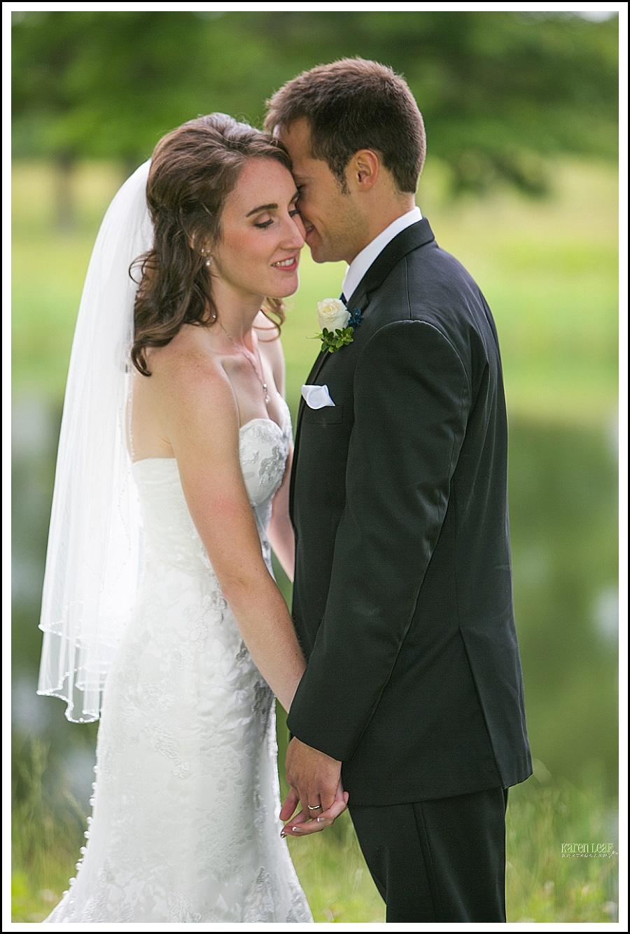 bride and groom formal in field