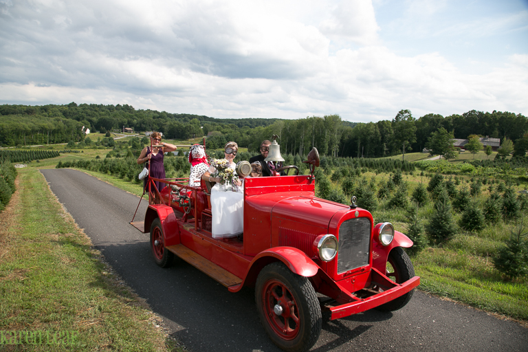 vintage firetruck bringing bride to wedding-6