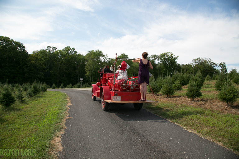 vintage firetruck bringing bride to wedding-7
